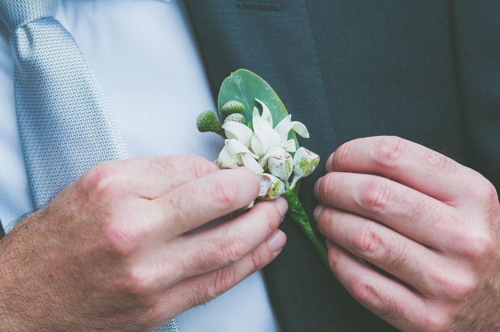 Attaching man flower - Weddings - Photo credit Nicola Bailey.jpg