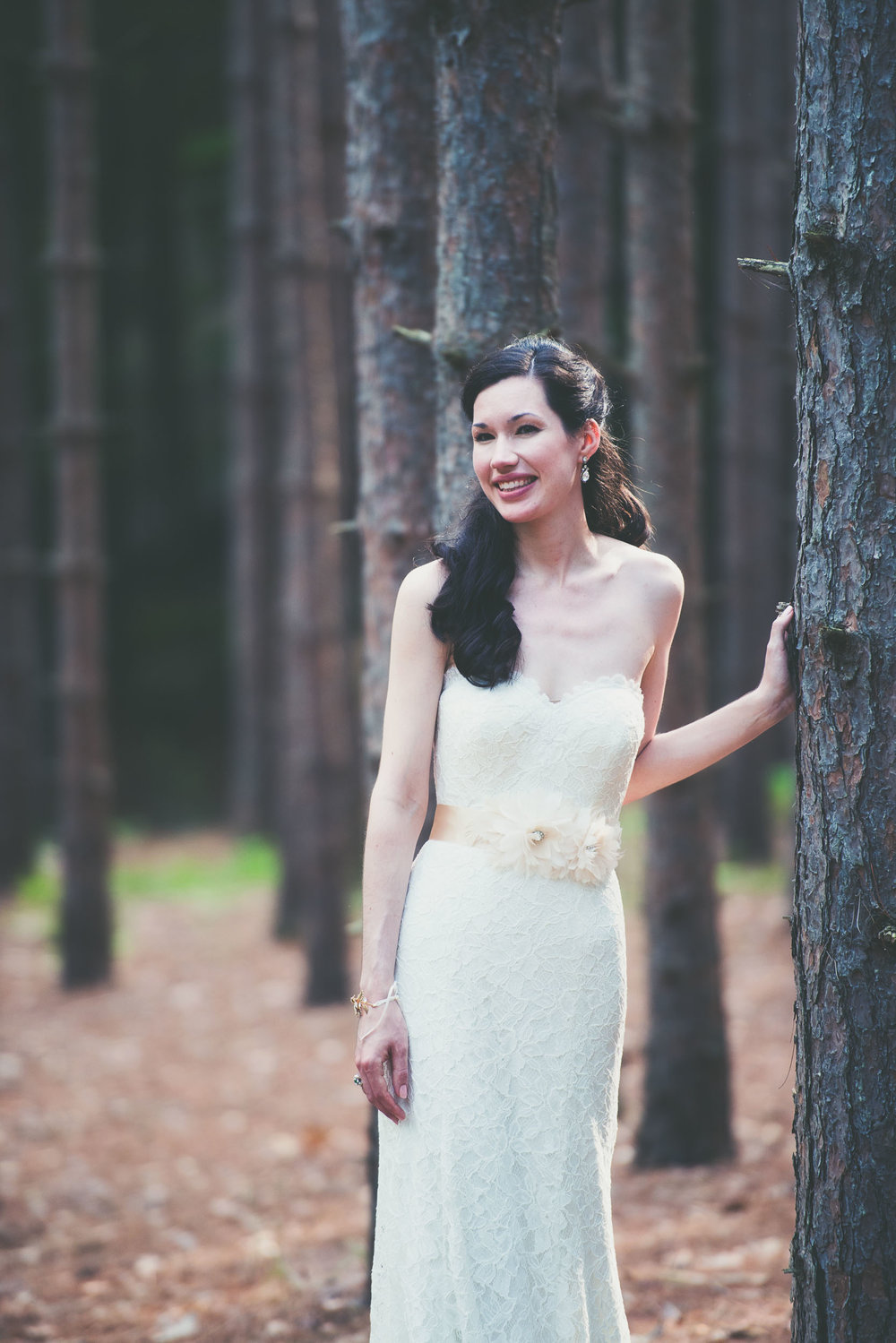 Bride against tree - Weddings - Photo credit Nicola Bailey.jpg