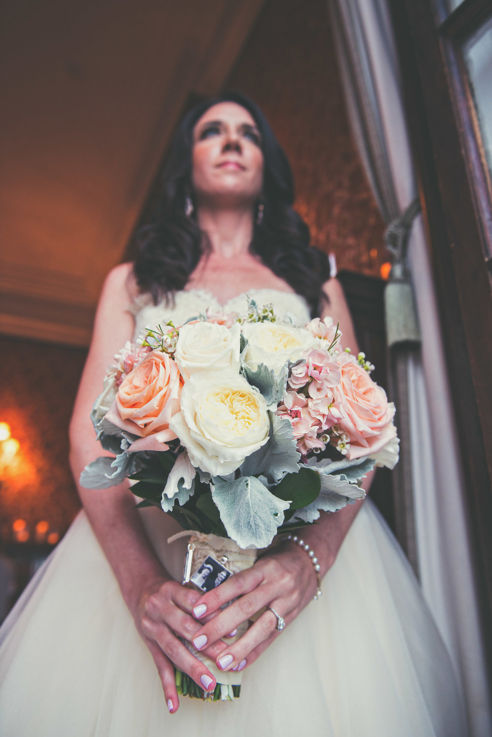 Bride with flowers - Weddings - Photo credit Nicola Bailey.jpg