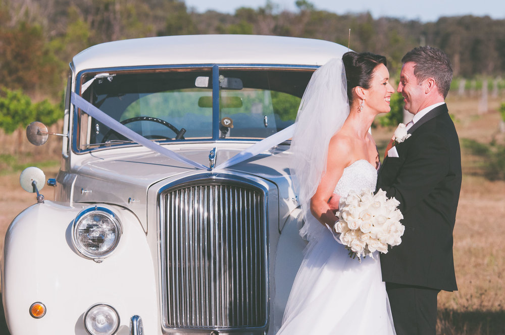 Couple in front of one car - Weddings - Photo credit Nicola Bailey.jpg