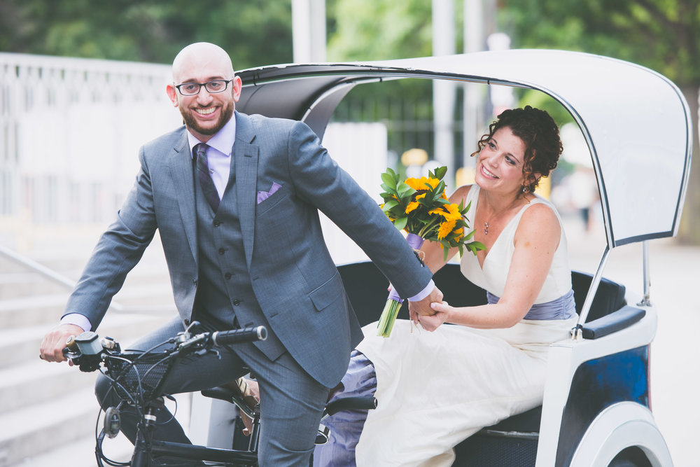 Couple on a bike at wedding - Weddings - Photo credit Nicola Bailey.jpg