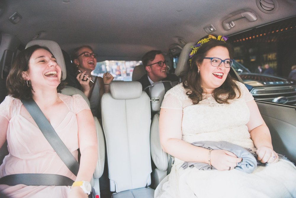 Laughing in car - Weddings - Photo credit Nicola Bailey.jpg