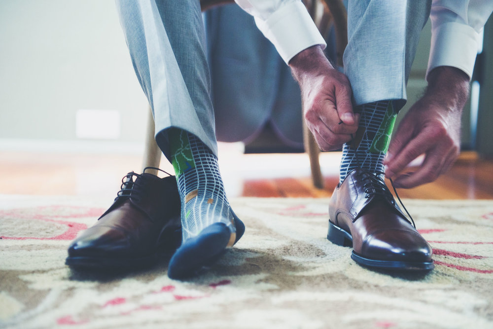 Putting on shoes - Weddings - Photo credit Nicola Bailey.jpg
