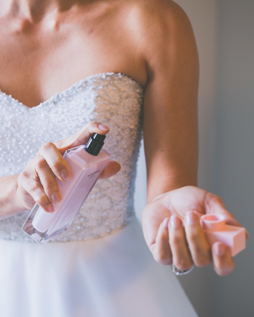 Spraying perfume - Weddings - Photo credit Nicola Bailey.jpg