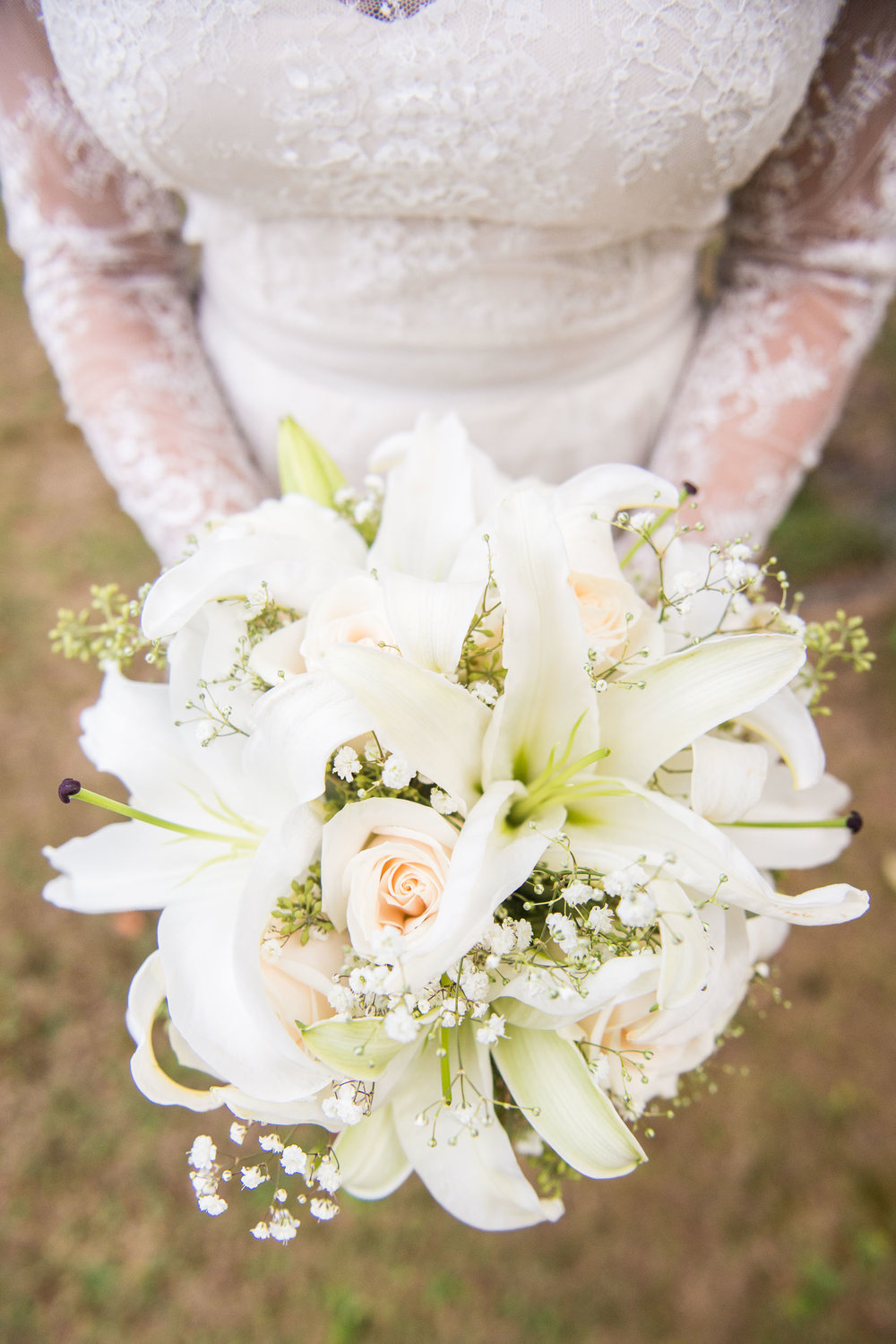 Hands with bouquet - Weddings - Photo credit Nicola Bailey.jpg