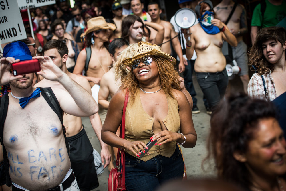 Topless march smiling woman - Current events - Photo credit Nicola Bailey.jpg