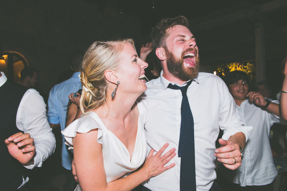 Laughing bride and groom - Weddings - Photo credit Nicola Bailey.jpg