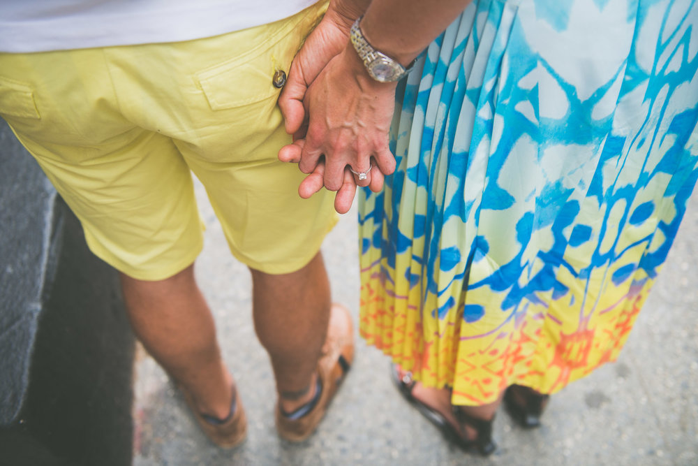 Couple holding hands from behind - Engagement Portraits - Photo credit Nicola Bailey.jpg