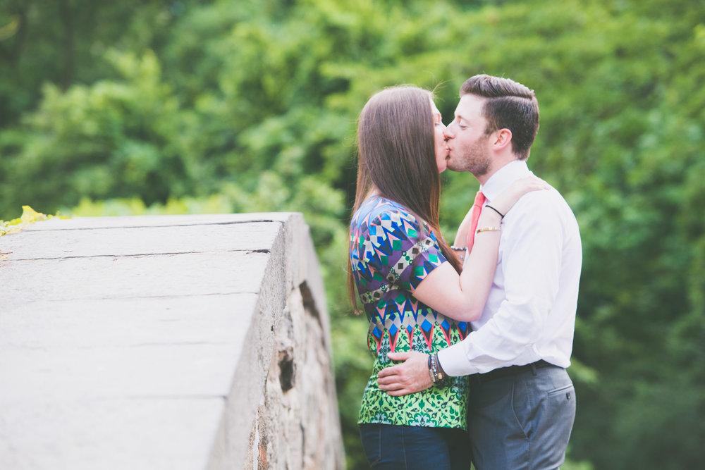 Couple kissing on Gapstow Bridge - Engagement Portraits - Photo credit Nicola Bailey.jpg