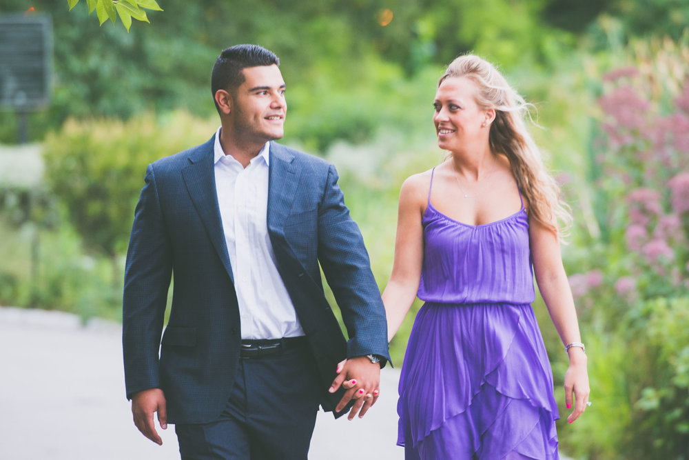 Couple walking through gardens - Engagement Portraits - Photo credit Nicola Bailey.jpg
