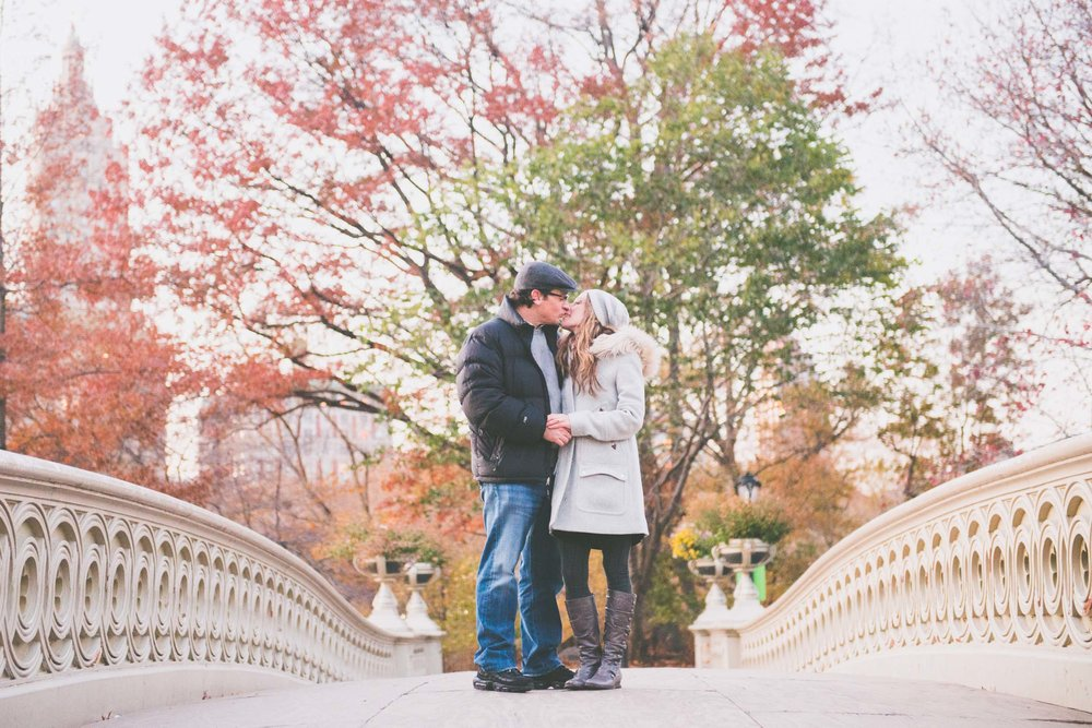 Kissing on Bow Bridge - Engagement Portraits - Photo credit Nicola Bailey.jpg