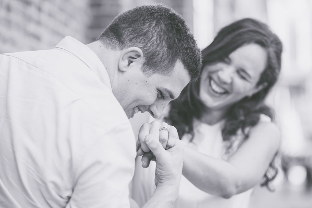 Laughing looking at ring - Engagement Portraits - Photo credit Nicola Bailey.jpg