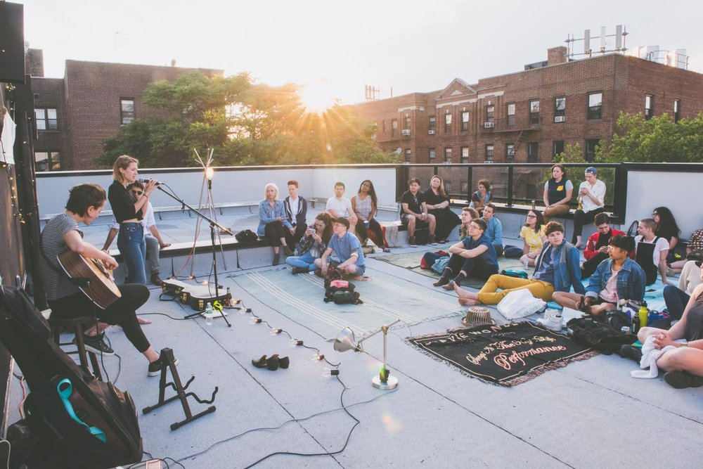 People sitting round on a roof top - Photo credit Nicola Bailey.jpg