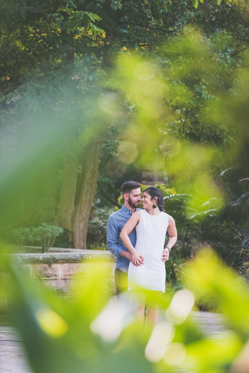 Engagement portrait - Couple looking at each other in Botanic Gardens Sydney - Photo credit Nicola Bailey.jpg