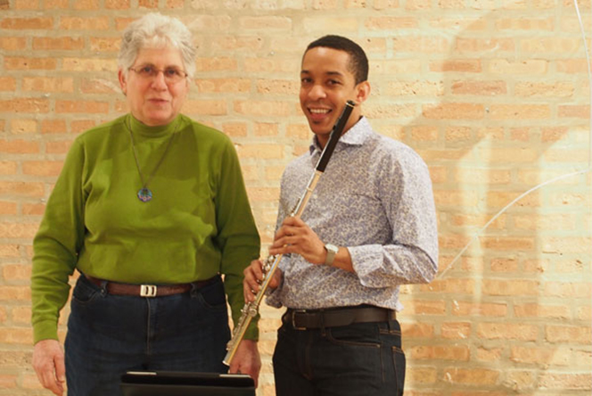 ICE flutist Eric Lamb explains the fine points of Phyllis Chen's score to Arlene Dunn