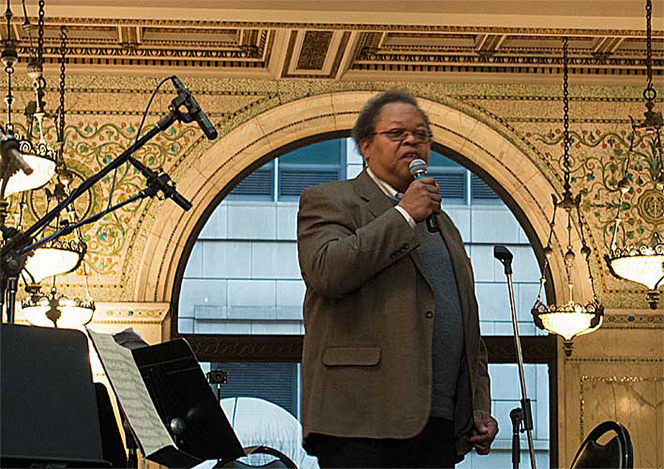 Composer George Lewis introducing the ICE program of his works combined with the Schubert Octet at Chicago Cultural Center