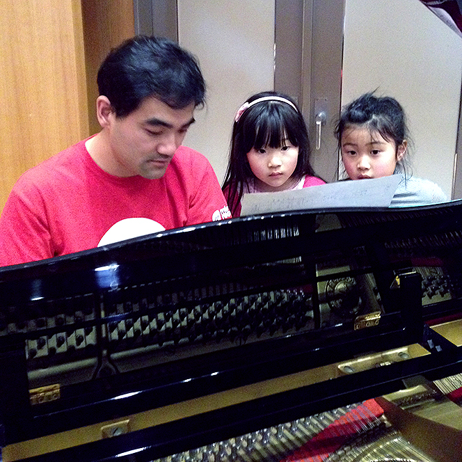 Composer Dai Fujikura works with two of Soma City's young composers.