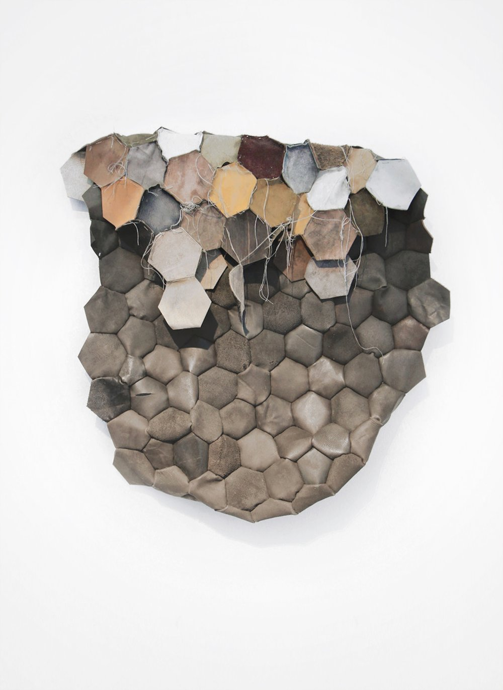 Unifying polarities , Found leather treated with copper slag powder.