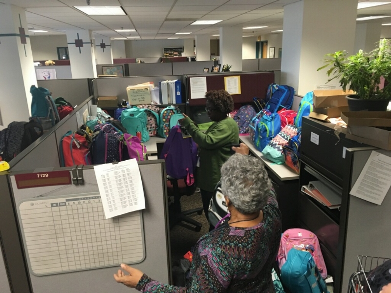 Social workers filling up their work cubes with Foster the Love MN backpacks ready to be delivered!