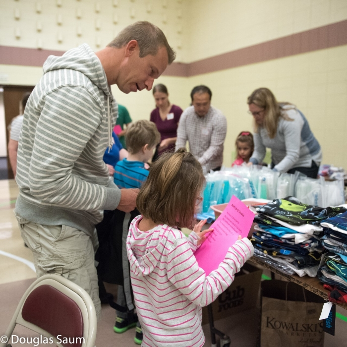 Volunteers of all ages worked alongside church members from 10 different churches to put together 100 placement bags!