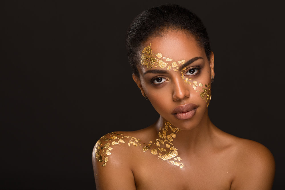 Beautiful young black woman with makeup