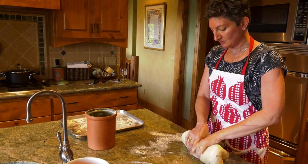 Rabbi Francine kneading challah bread