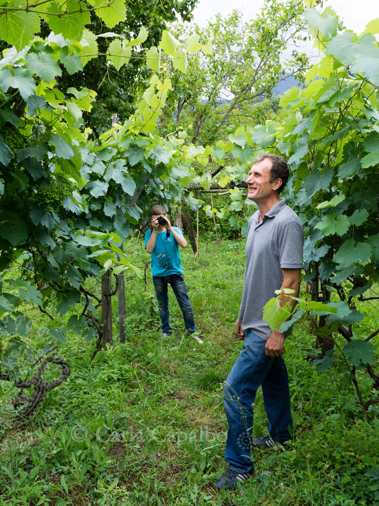 Archil Guniava and son in their vineyard