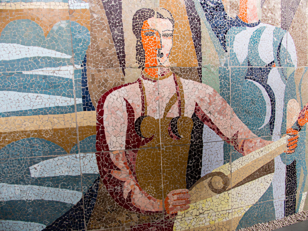 Soviet-era mosaics in a large mural in Tbilisi