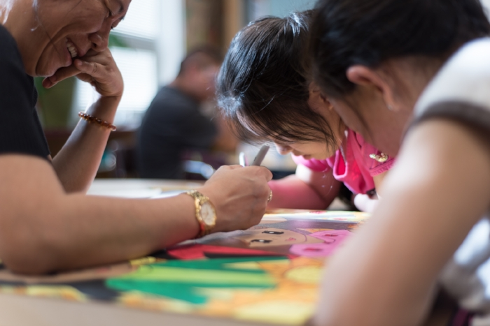 Families making art together -