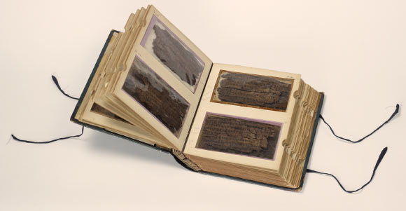 The Bakhshali manuscript contains the oldest recorded example of the symbol that we use for zero today. The 70 leaves of birch bark that make up the manuscript are incredibly fragile and are housed in this specially designed book at the Bodleian Libraries' Weston Library, Oxford. Scholars are able to view both sides of the birch bark through the 'windows' of the book. Image credit: Bodleian Libraries, University of Oxford.