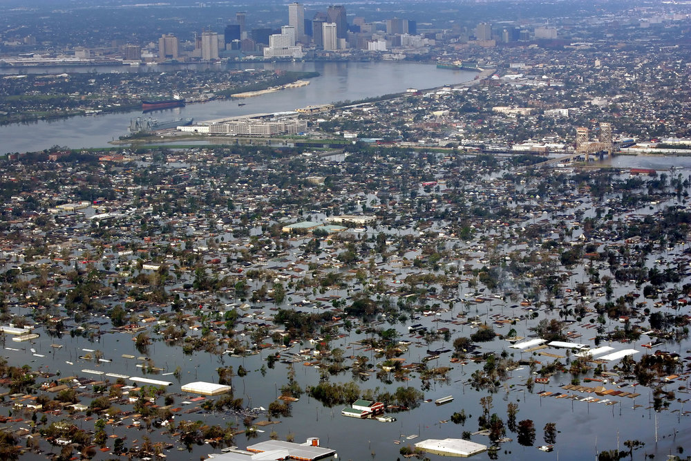FILE - In this Aug. 30, 2005 file photo, floodwaters from Hurricane Katrina cover the lower ninth ward, foreground, and other parts of New Orleans, a day after the storm passed through the city. It's not just this year. The monster hurricanes Harvey, Irma, Maria, Jose and now Lee that have raged across the Atlantic are contributing to what appears to be the most active period for major storms on record. (AP Photo/David J. Phillip, File)
