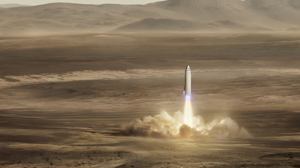 This artist's rendering made available by Elon Musk on Friday, Sept. 29, 2017 shows SpaceX's new mega-rocket design on Mars. With the 350-foot-tall spacecraft, Musk announced that his private space company aims to launch two cargo missions to the red planet in 2022. (SpaceX via AP)