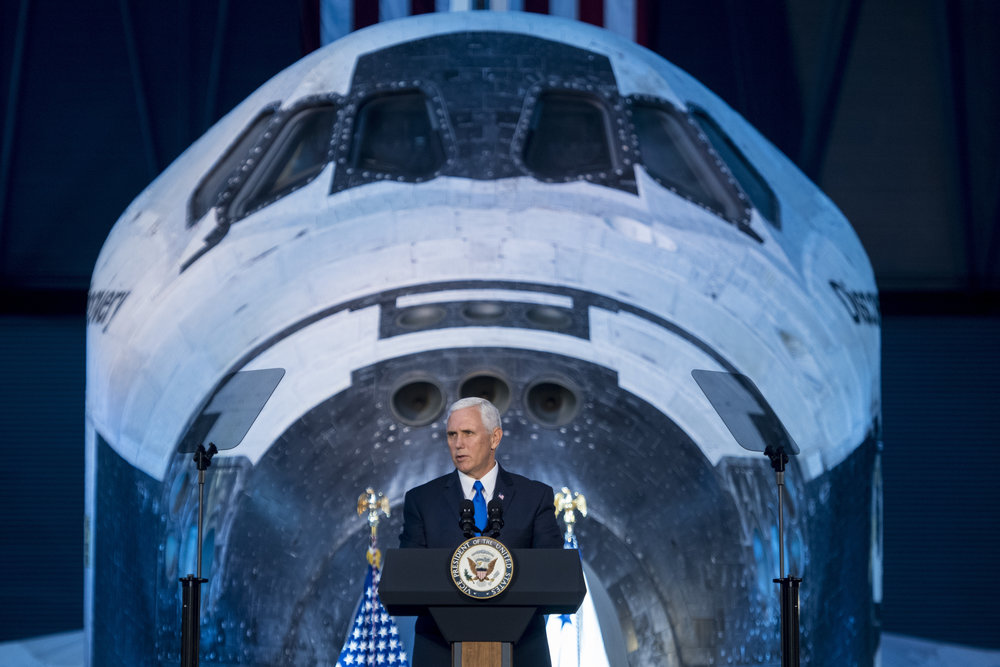Vice President Mike Pence delivers opening remarks during the National Space Council's first meeting, Thursday, Oct. 5, 2017 at the Smithsonian National Air and Space Museum's Steven F. Udvar-Hazy Center in Chantilly, Va. The National Space Council, chaired by Pence, heard testimony from representatives from civil space, commercial space, and national security space industry representatives. (Joel Kowsky/NASA via AP)