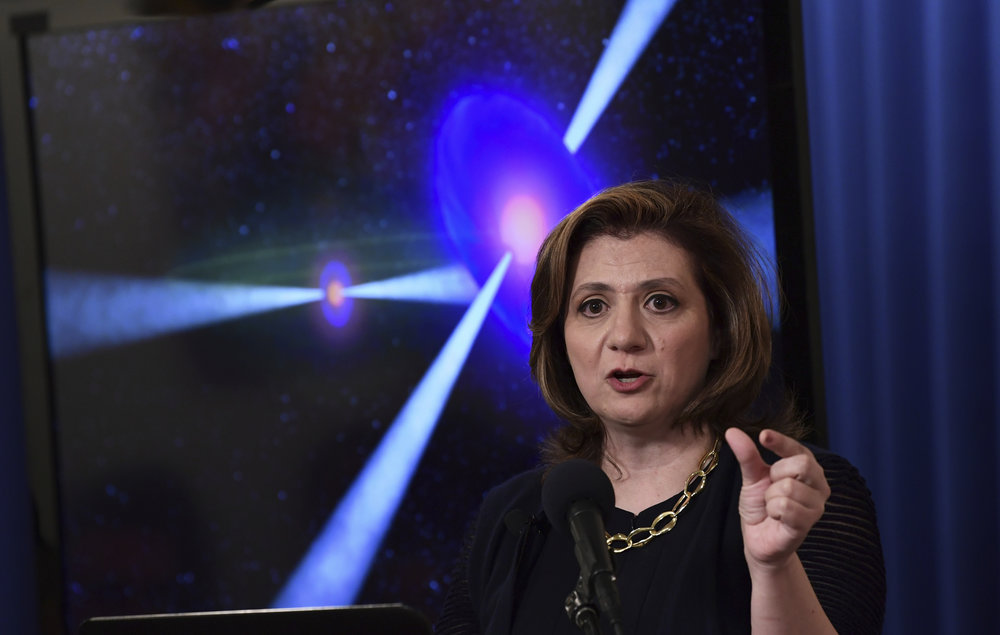 Vicky Kalogera, a gravitational-wave astrophysicist at Northwestern University who contributed to the historic detections of gravitational waves, speaks at the National Press Club in Washington, Monday, Oct. 16, 2017, during an announcement on one of the most violent events in the cosmos that was witnessed completely for the first time in August and tells scientists where gold and other heavy elements come from. (AP Photo/Susan Walsh)