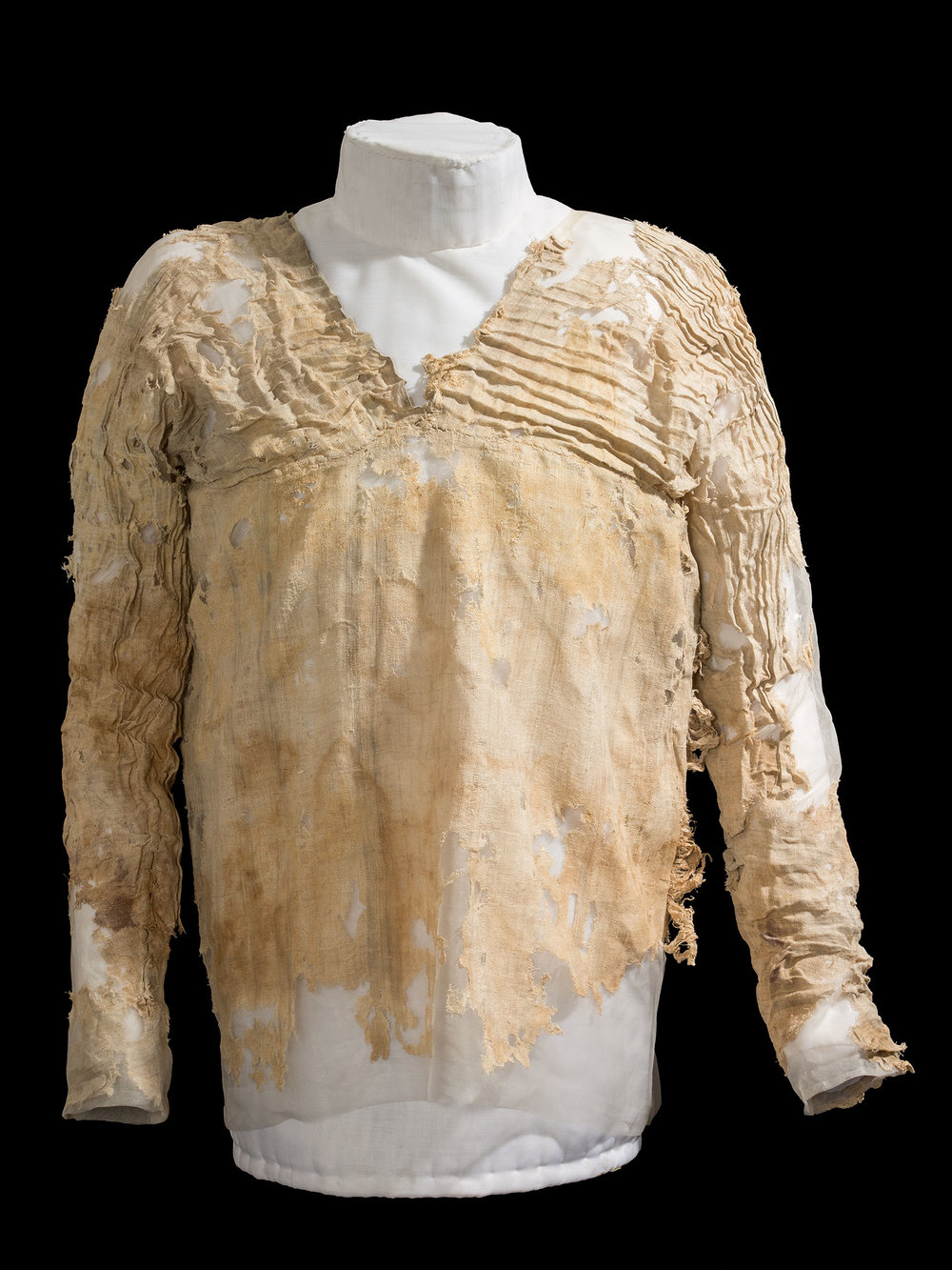 (Courtesy Petrie Museum of Egyptian Archaeology). The Tarkhan Dress likely was worn by a young or slim female member of the royal court, and then placed in the tomb as a funerary object. Although the bottom does not survive, it may once have been full-length.