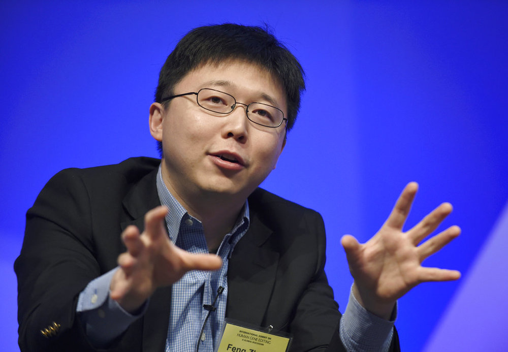 Feng Zhang of the Broad Institute of MIT participates in a panel discussion at the National Academy of Sciences international summit on the safety and ethics of human gene editing, in Washington. Scientists are altering a powerful gene-editing technology in hopes of one day fighting diseases without making permanent changes to people's DNA. (AP Photo/Susan Walsh)