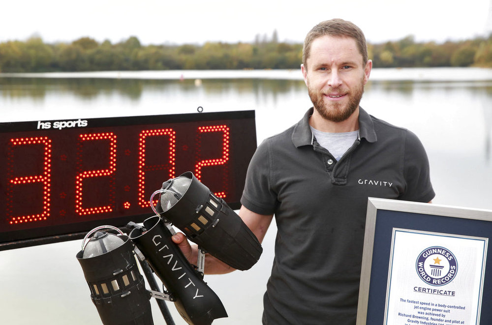 Richard Browning poses for the media after setting the Guinness World Record for 'the fastest speed in a body-controlled jet engine power suit', at Lagoona Park in Reading, England, Thursday, Nov. 9, 2017. A British inventor billed as a real-life version of the superhero Iron Man has hit the fastest speed in a body-controlled jet engine power suit at 32 mph (51 kph) to set a new Guinness world record. The record keeper announced Tuesday's feat on Thursday as part of its annual Guinness World Records day. (Matt Alexander/PA via AP)