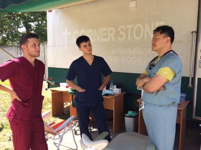 Dr James Wu teaching dental students.jpeg