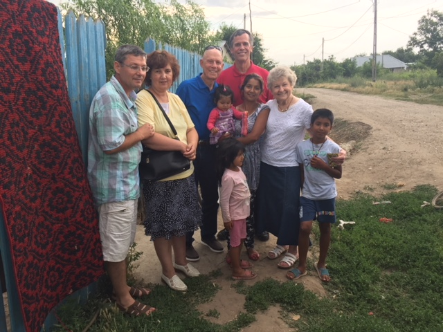 Village ministry with Pastor Florine to encourage a young mother who is a church member.JPG