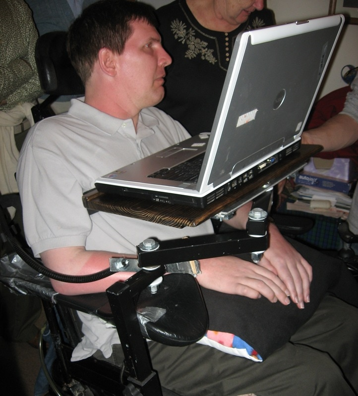 Frank, who had MS needed help to hold his laptop for communicating while out and about in his w/c. you can see it is mounted on the arm of his w/c and swings around when he needs it.