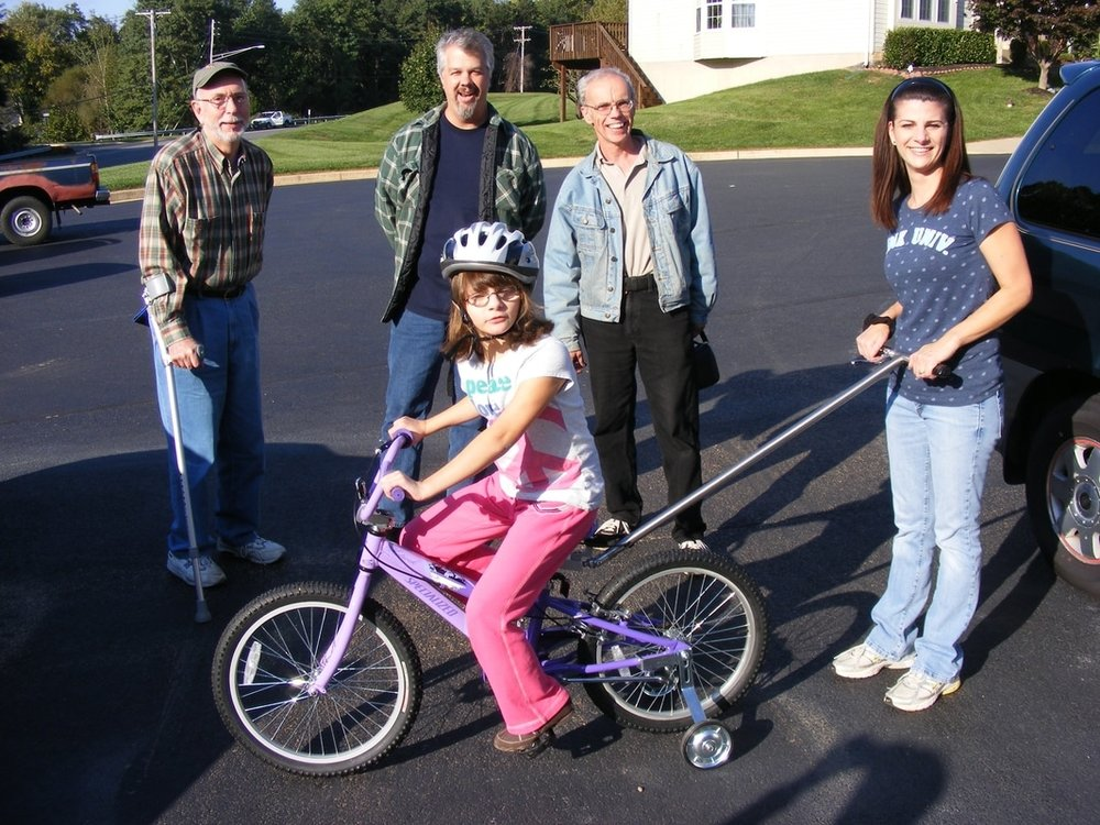 Kayla's mom is happy now that Kayla can ride a bike and be safe - mom has a remote brake!