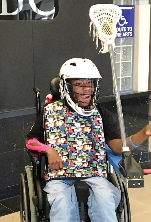 "Terrence has CP, is non-verbal, and LOVES his Lacrosse Team! We found a team at UMBC that created a ""catapult"" for him to use to throw the ball."