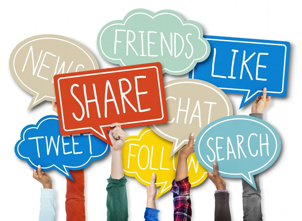 "Seven hands are holding multi-shaped, multi-colored, flat balloons, with the words, ""tweet"", ""news"", ""share"", ""friends"", ""follow"", ""chat"", ""like"", ""search"""