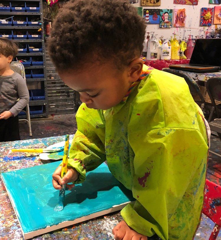 Preparing a canvas- Our Toddlers use professional artistic materials!