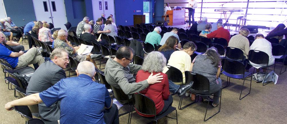 IMF members gather to pray.
