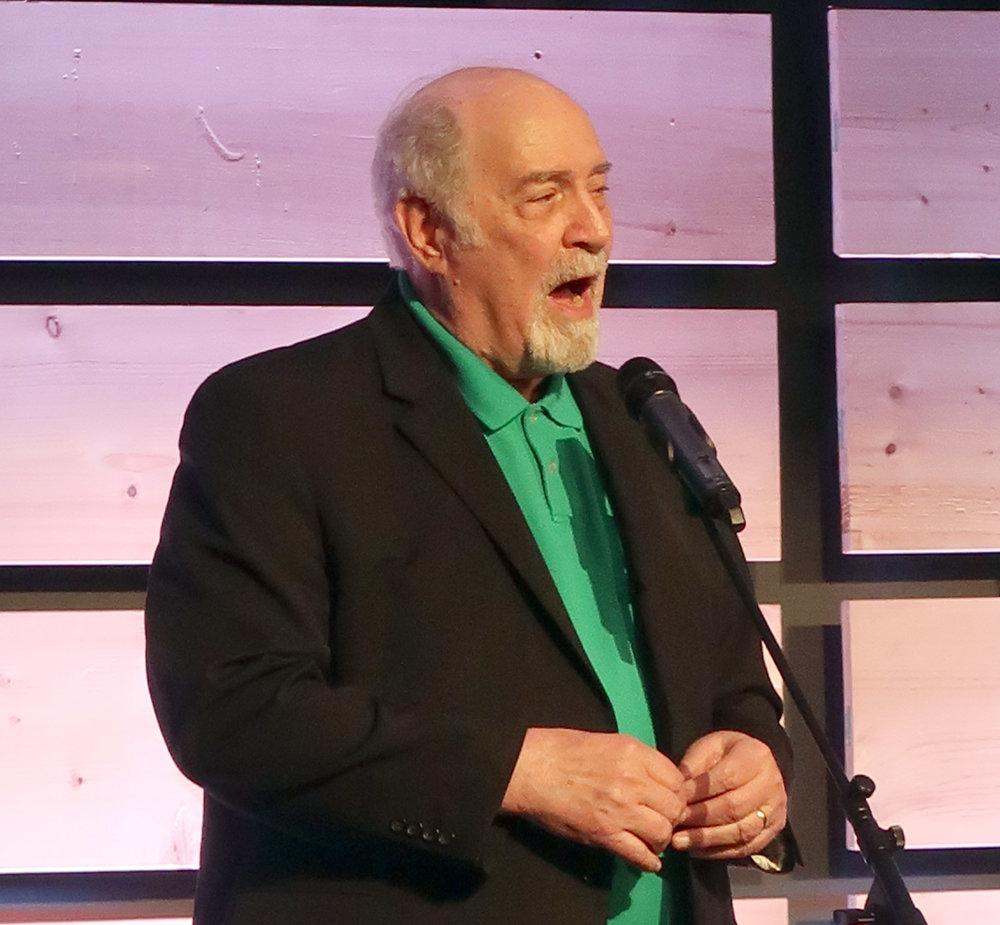 Rev. Ken Carter leads in song.