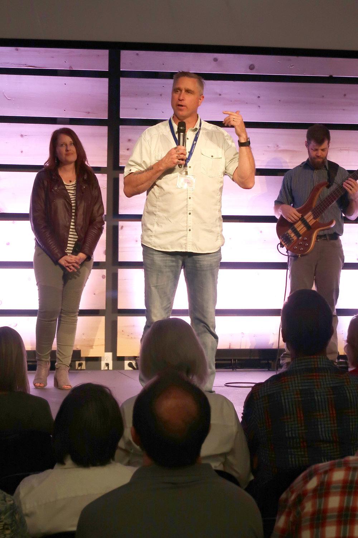Pastor John Braland encouraging IMF Members.