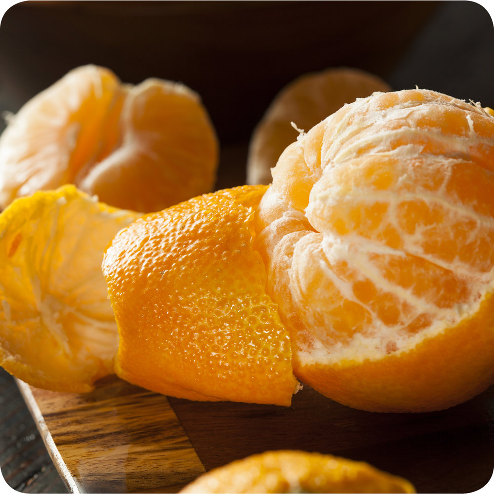 A partially peeled  Citrus sinensis  fruit (orange).