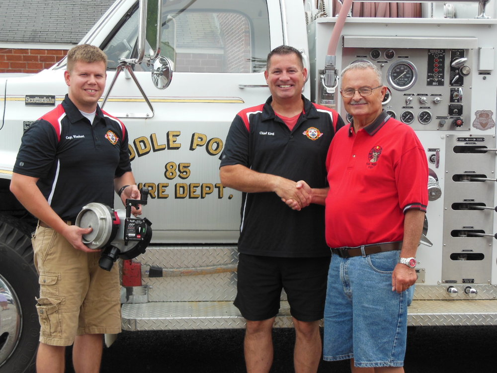 Pictured, left to right with the new piece of equipment is: Fire Captain Nate Wiechart, Fire Chief Craig King and Lodge Community Service Grant Chairman Michael C. Stanley.