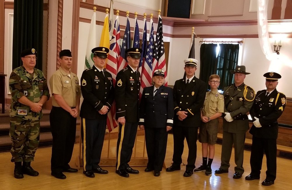 Pictured are the Flag Carriers: A veteran (member Tim Caldwell), active duty service men and woman, a fireman, a boy scout, a Licking County Sheriff Deputy (member Justin Woodyard) and a city policeman.